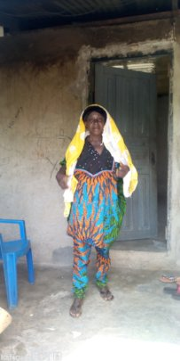 Salamatu in front of her home
