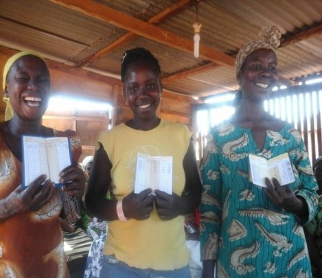 Group members display savings books