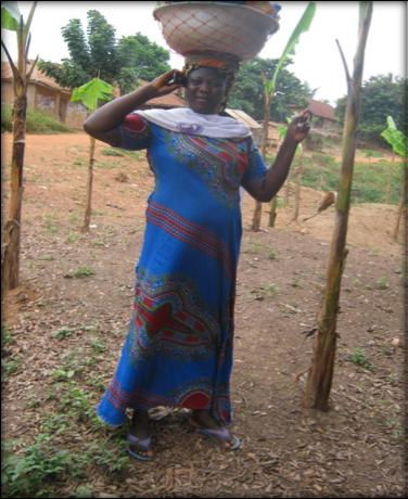 Farmer utilizing her cell phone