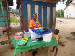 Lucy selling food in her community.