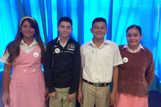 Students wearing their mangrove guardian badges.
