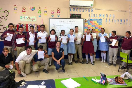 Workshop teacher and class.