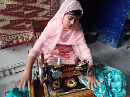 Sewing clothes at a tailoring shop