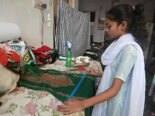 Muskaan learning how to stitch