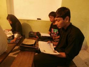 Ali reads in class