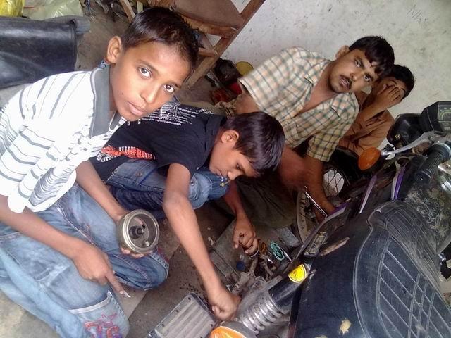 Talking to children working in auto-repair shops
