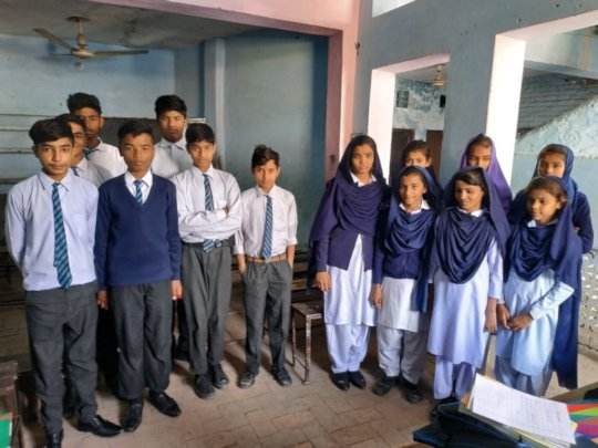 Simran with her fellow secondary school students