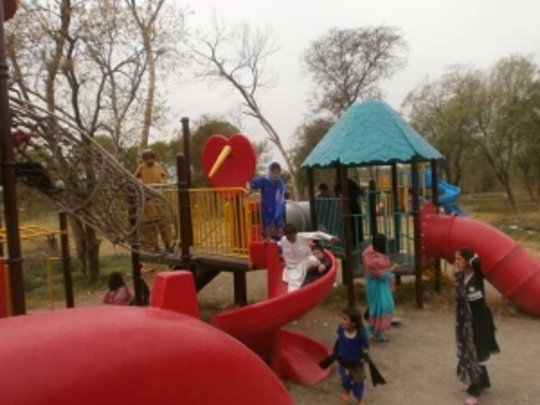 students enjoy the play area at the park