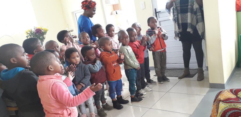 Children celebrate their new school