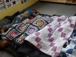 Children sleeping under blankets of joy