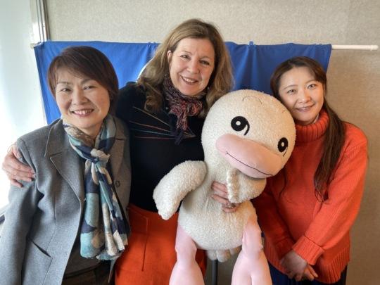 Gina at Chupie FM holding radio mascot