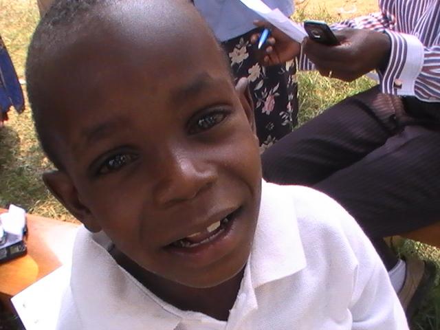 Yusuf Mubiru happy after receiving 20 kgs of rice