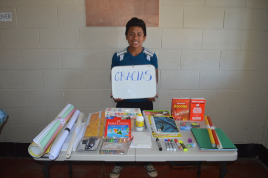middle school student getting his supplies