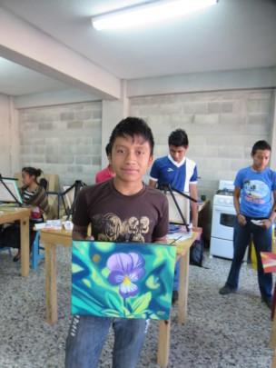 Pedro showing his artwork