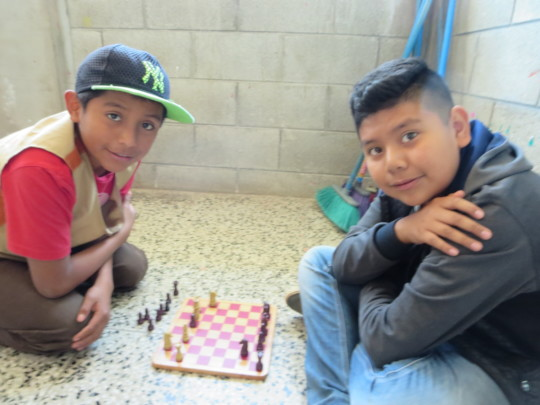 Grade 5 students learning chess