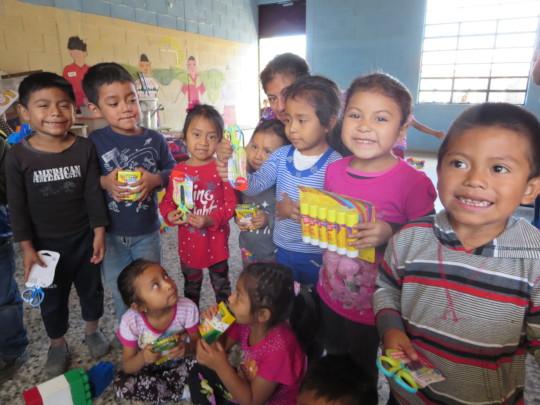 Kinder class receiving teaching supplies