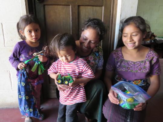 New sponsor family receiving toys
