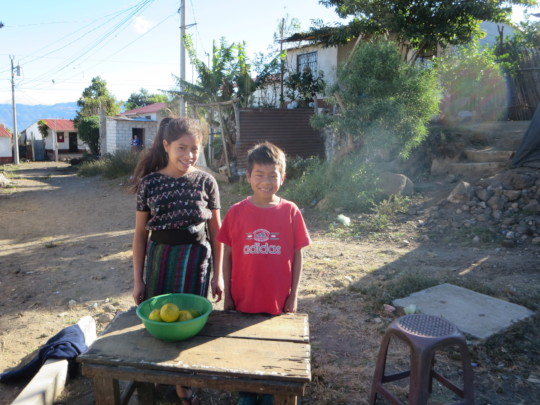 Samuel and Ana selling oranges to get food money