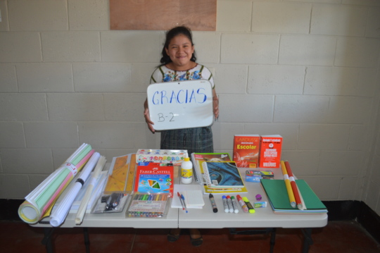 A new sponsored student with her supplies