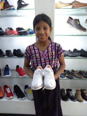 Sandra getting her first pair of new school shoes