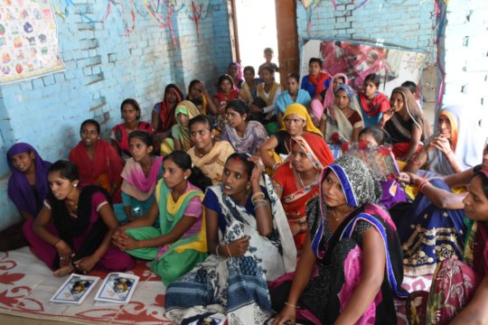 Empower Foundation team interacting with women .