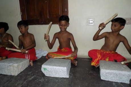 Musical instruments for 17 slum children in India