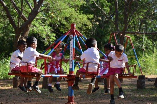 The new merry-go-round at Chuti Tharu preschool.