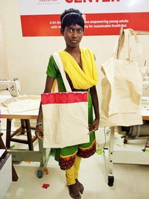 Posing with a cloth bag she made
