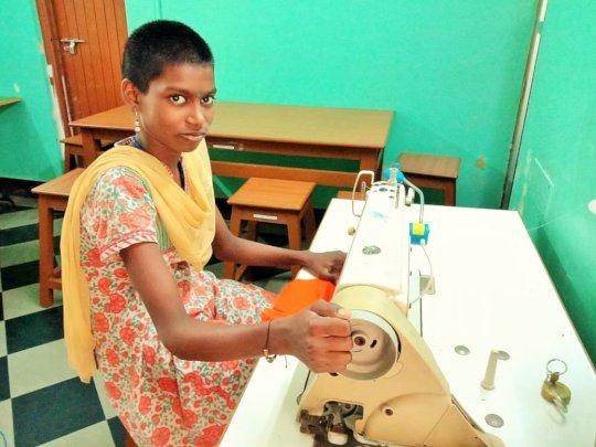 Nithya at her sewing machine