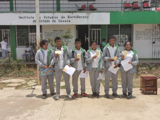 Students of the program receiving their scholarshi