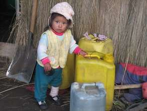 Little child with water jug