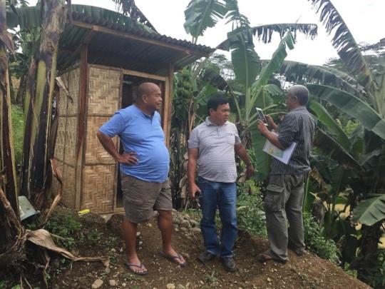 Inspecting new latrine
