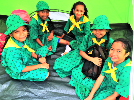 Girl Scouts happy in their new tent!