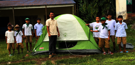 Boy scouts prepare tent for camping