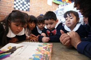 Teacher Aurelia Guerrero reads a story to her class.