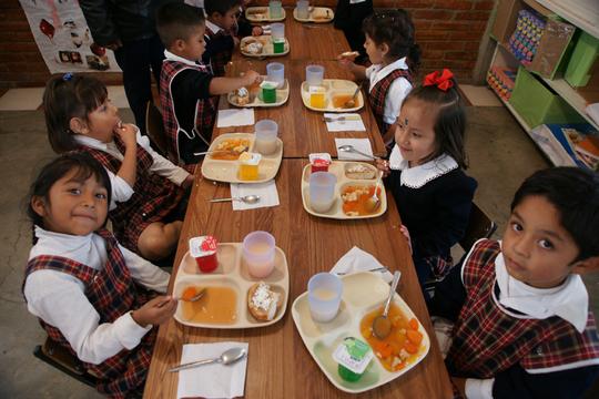 Preschoolers enjoy their balanced lunch.