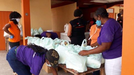 Volunteers packing food parcels