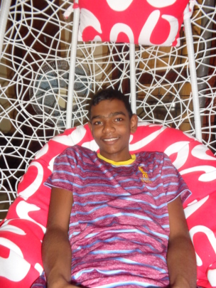 Ravi enjoys time on a special swing
