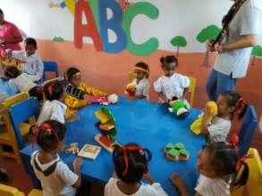Children in rebuilt school classroom