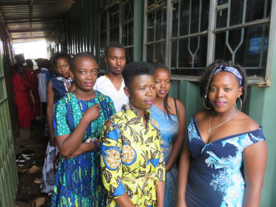 Fashion and fabric design students at graduation