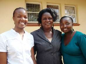 Headteacher Florence with Mercy and Rosabella