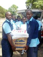 Students receive the paper for recycling