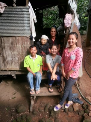 New with her father, younger sister, and granny