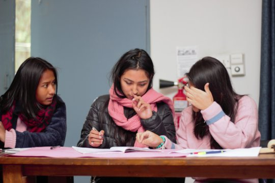 Anu, Bini and Prekchhya working on a proposal