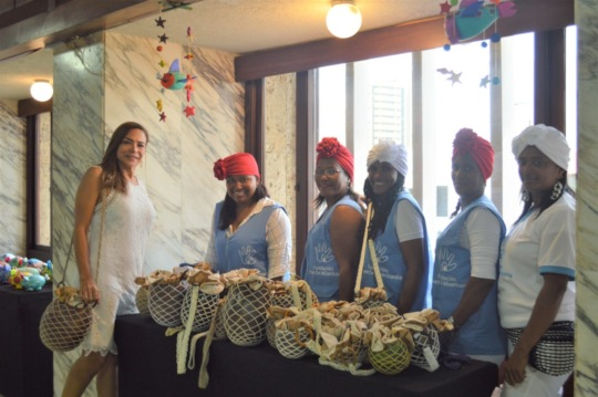 Women From Tierra Bomba Presenting Their Creations