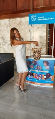 Our Founder Modeling Handmade Purses