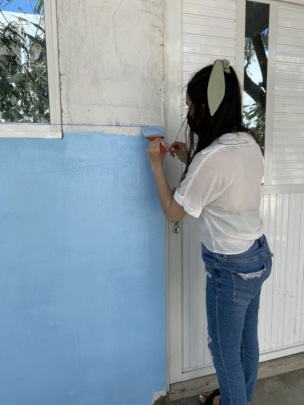 Volunteers at Work Painting