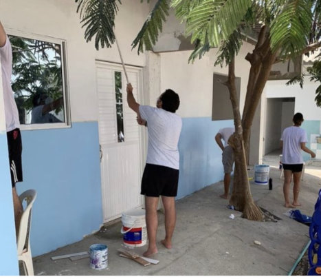 Volunteers Painting For a Dream