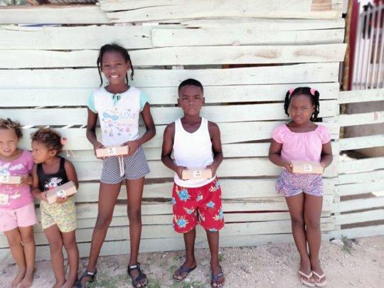 Little Ones of Tierra Bomba Receiving Lunch