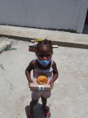 Little Girl of Tierra Bomba Receiving Lunch